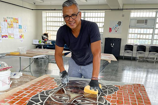 Artist Edwin Gil and his Faces of Diversity mural for HELP USA's Meyer Mental Health Shelter