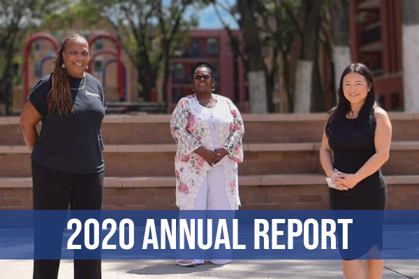 """Three women are standing on the grounds of a HELP USA housing site. There is a blue band across the image with the text """"2020 Annual Report"""" written on it."""